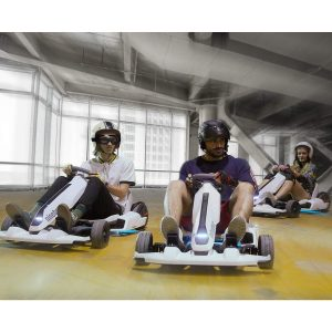 Adults driving go karts indoors